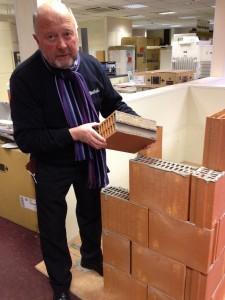 Group Leader, Brian Layton, trying his hand at laying the blocks