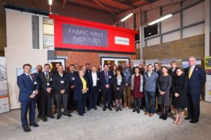 Fabric First Institute launch at Easton and Otley College, Easton, Norwich. All the sponsors gather in front of the completed building. Photography by Simon Finlay Photography.