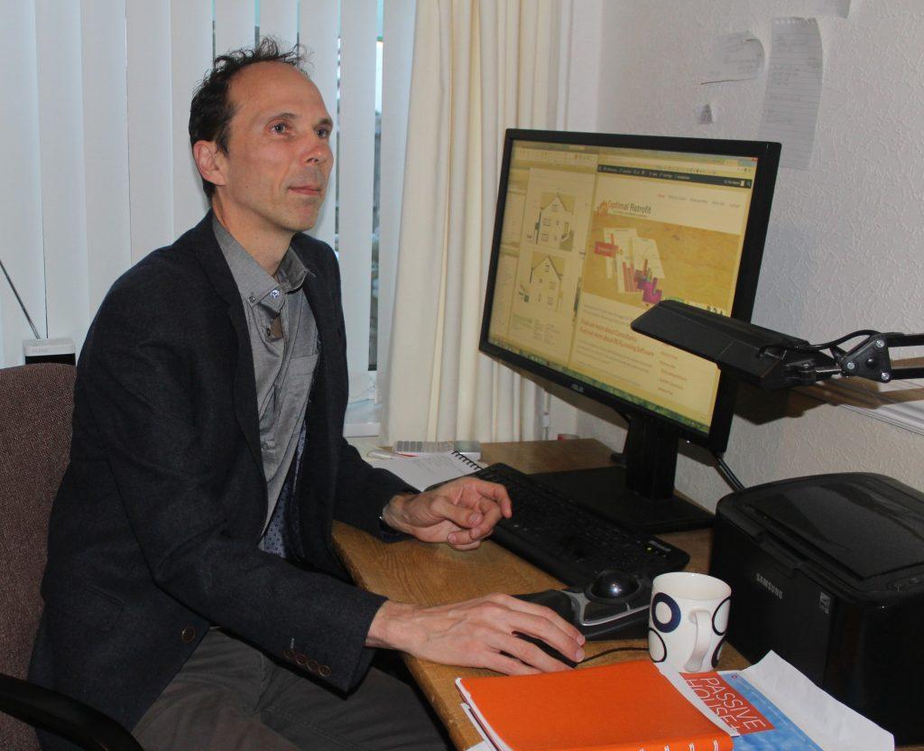 Tim Martel working on computer